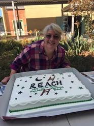 Jill Cavanaugh poses with REACH cake for the band