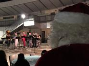 ensemble plays while Santa looks on at MESA Winter Wonderland event