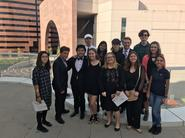 students go to Segerstrom Concert Hall to see the LA Phil and pose for a picture