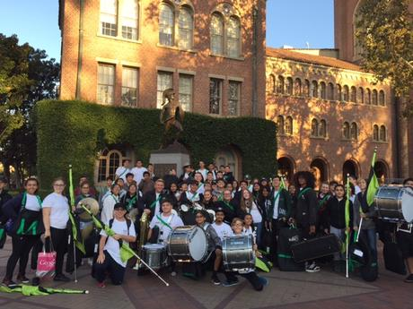 Marching Band pose at Tommy Trojan statue at USC