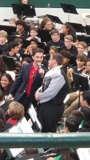 Nick St.Royal acknowledges Zaid Batarseh at District band festival